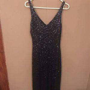 Floor length navy blue sequined dress.